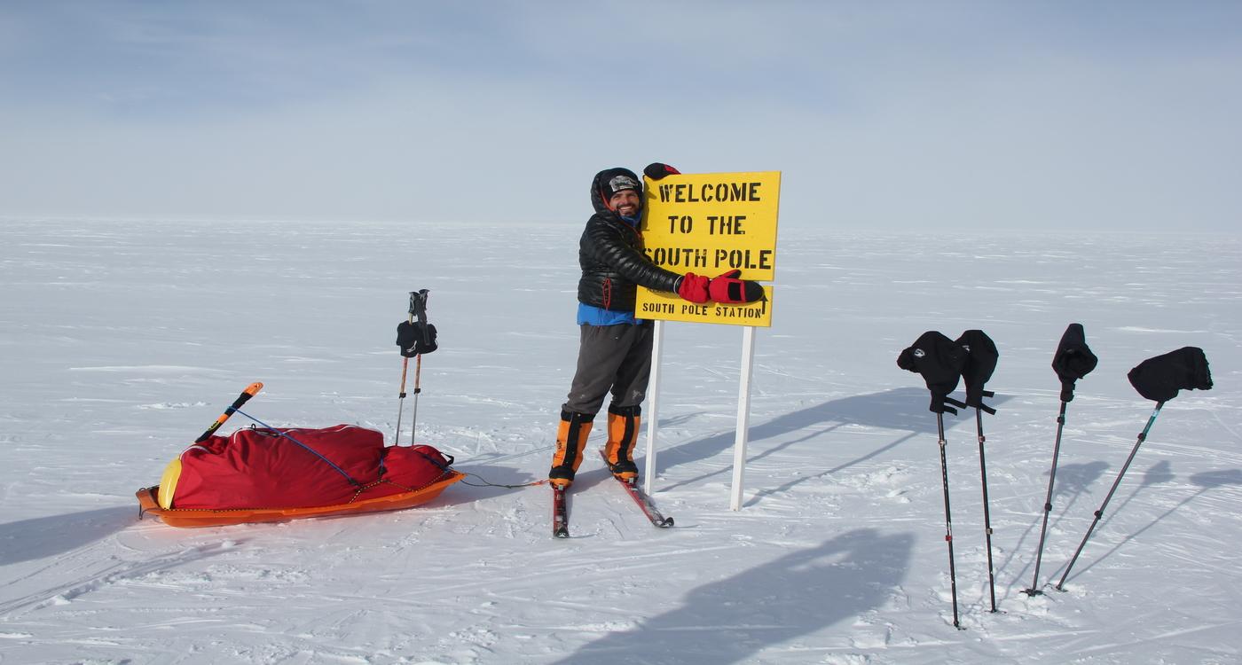 South Pole camp sign post hug